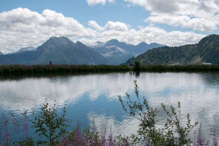 The clouds and mountains' reflection on the calm lake