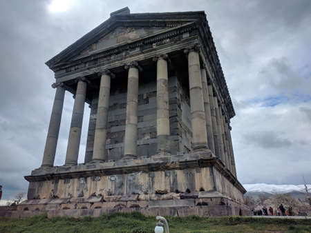 A low angle shot of the famous Garni temple in Armenia on a cloudy day
