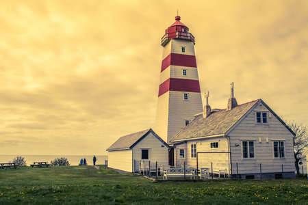 ALNES, NORWAY - Alnes lighthouse was established in 1852 to guide fishing boats safely to the harbor of the small fishing community of Alnes on Godoy island