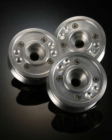 A vertical shot of spacer adapter for drives isolated on black background Stock Photo