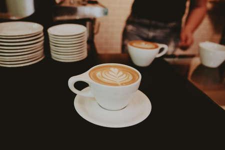 A closeup shot of a beautifully made cappuccino with flower foam art