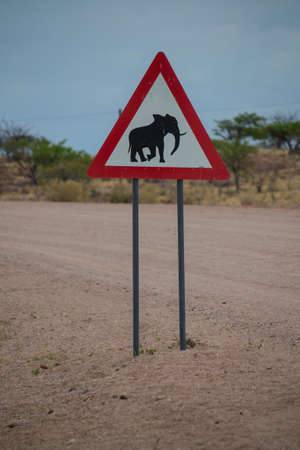 A vertical shot of a triangle road elephant sign Imagens