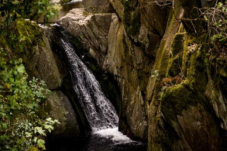 A mesmerizing scenery of waterfall cascading over rocks Standard-Bild