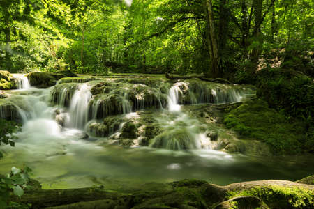 A beautiful view of a waterfall in Cascade de Tufs near Arbois, France Stock Photo
