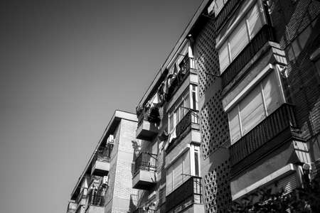 A low angle shot of a building in grayscale