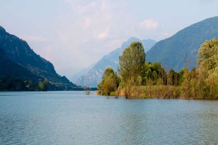 With mountains in the background, trees in the middle next to the lake, it feels like paradise
