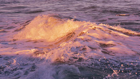 A beautiful shot of the waves of the sea on a sunny day at the beach