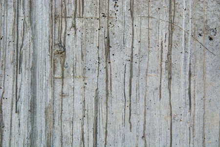 A closeup shot of naturally weathered grungy wall with oil paint leftovers on marble