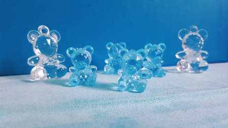 A wide closeup shot of blue and white crystal decorative figurines