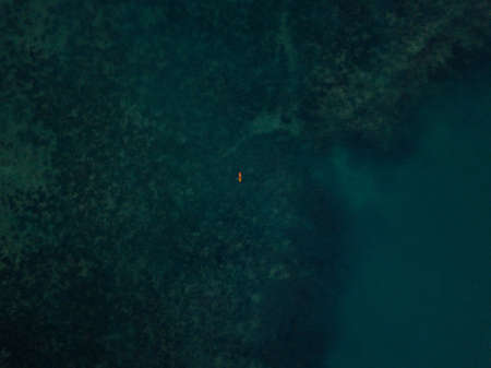 A lonly boat on the big blue ocean. Aerial drone shot.