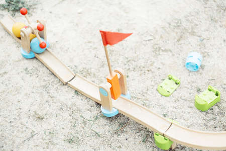 An overhead shot of wooden road toys with balls on the ground 版權商用圖片