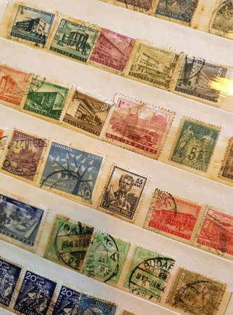 SOVATA, ROMANIA - Jul 02, 2020: A page from a philatelic catalog with many old stamps