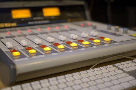 A closeup shot of professional radio station equipment or control panel