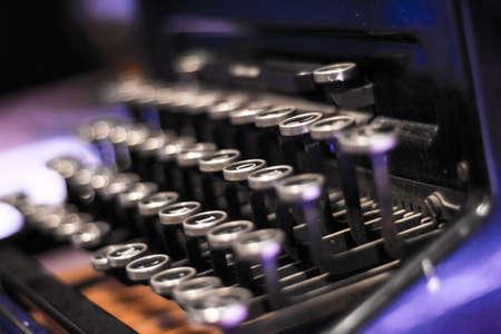 A closeup shot of a black typewriter