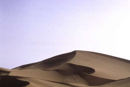 A wide shot of a sandy erg desert