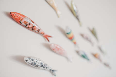 Colorful ceramic fish decors on a white wall