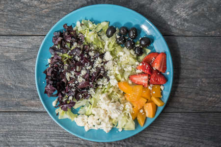 A closeup shot of a vegetable and fruit salad