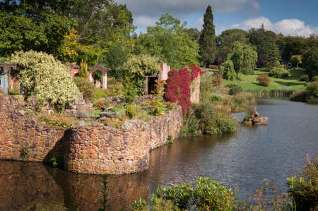 a landscape view of a large garden in an English country estate