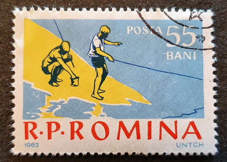 SOVATA, ROMANIA - Jul 02, 2020: old Romanian stamp 1962 with a fishing theme, fisherman Stok Fotoğraf