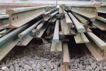 A closeup shot of old rusty railway scraps Foto de archivo
