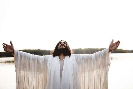 The Jesus Christ with his hands towards the sky