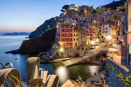 A beautiful high angle shot of the illuminated Cinque Terre sea Manarola Vernazza Rio Maggiore in Italy 版權商用圖片