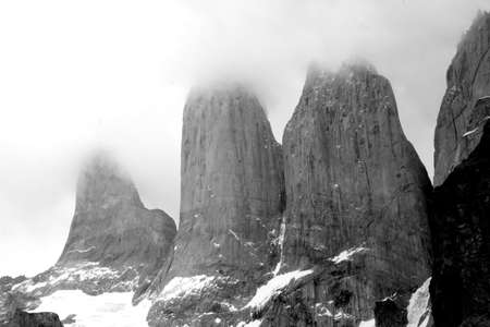 A beautiful grayscale shot of the mountains under the clear sky in Torres del Paine National park, Chile
