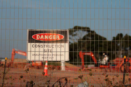 A horizontal shot of a danger construction site signage