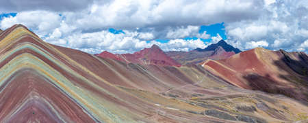 A landscape shot of the beautiful and colorful Rainbow Mountains in Peru. Perfect for a background.