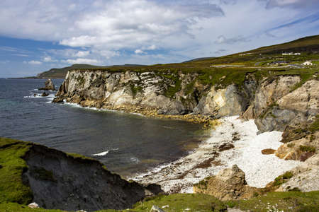 A beautiful scenery of the cliffs surrounding the sea in the Achill Island of Irish County Mayo