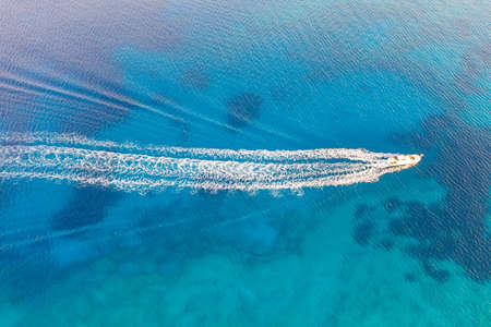 A beautiful high angle shot of a ship engine trail in the ocean Reklamní fotografie