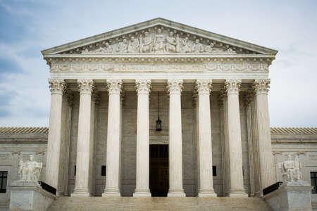 The famous United States supreme court building under the cloudy sky