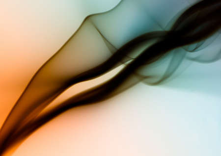 An abstract shot of the black smoke on colorful background - perfect for a cool vertical background