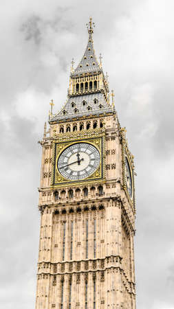 A low angle shot of the famous Big Ben in London under the cloudy sky Stock Photo