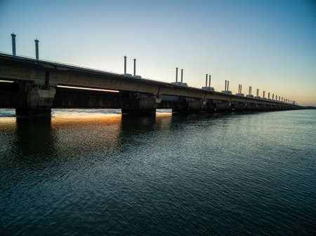 A beautiful shot of a storm surge barrier in Zeeland province of the Netherlands