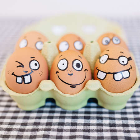 A beautiful shot of a package of eggs with cute grimaces depicted on them