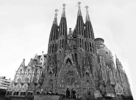 A low angle grayscale shot of the Expiatory Temple of the holy family in Barcelona, Spain Stock Photo