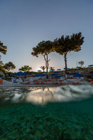 A vertical shot of the beautiful beach by the calm ocean captured in Samos, Greece