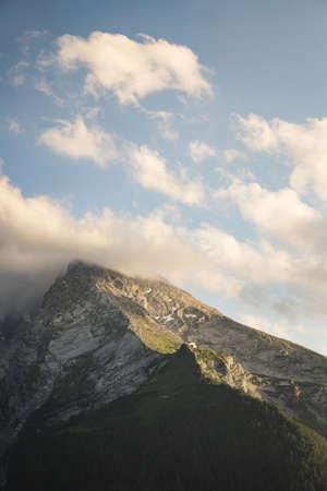 A vertical shot of the last golden light of the sun touching the Watzmann mountain in Berchtesgaden, Bavaria