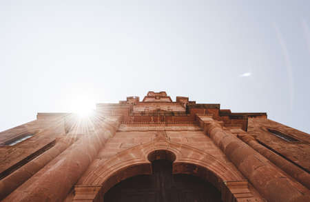 A low angle shot of a cathedral church with the sun shining in the background in Zacatecas Mexico