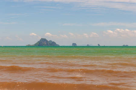 The ocean with calm waves moving towards the shore in Ao Nang Krabi, Thailand, Asia