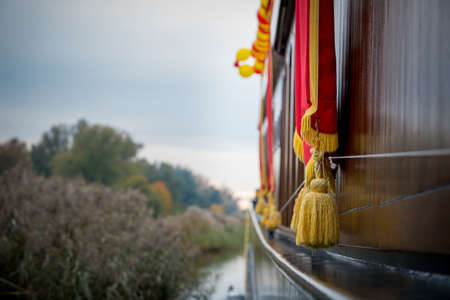A closeup selective focus shot of golden tassels hanging over a boat in Elburg, Netherlands Stock Photo