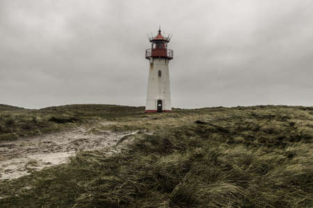 A low angle shot of the Lighthouse List East at Sylt, Germany under the storm clouds