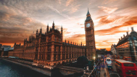 A low angle wide shot of the famous Big Ben in London with amazing sky and moving traffic on the side