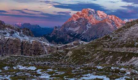A breathtaking shot of the Italian Alps during the sunrise in the colorful sky in the early morning