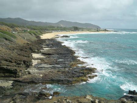 A beautiful scenery of a mountainous seashore in Hawaii