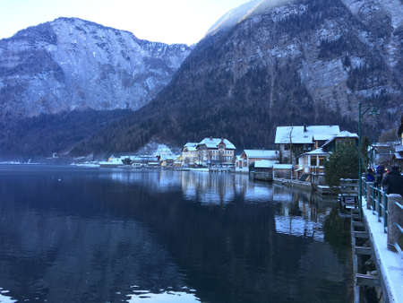 A beautiful scenery of the mountains reflecting in the lake in Hallstatt, Austria