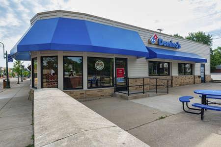 GRAND LEDGE, UNITED STATES - Jun 21, 2020: GRAND LEDGE, MI – June 21: Exterior view of the Domino's Pizza in Grand Ledge, MI on June 21, 2020 Editorial