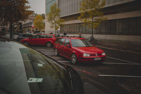 TURKU, FINLAND - Sep 23, 2018: A horizontal shot of a red Volkswagen near a building in the evening