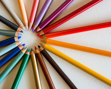 A circle made with color pencils on a white background - great for a cool background or wallpaper Фото со стока